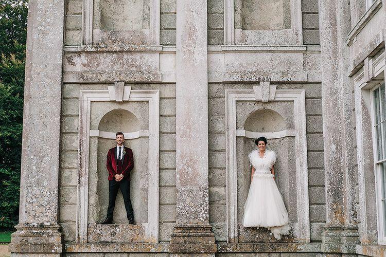Groom in Red Velvet Jacket & Bride In Vintage Feather Dress