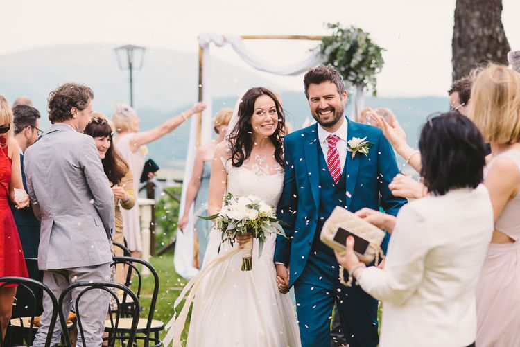 Outdoor Wedding Ceremony | Bride in Naomi Neoh | Groom in French Connection Suit