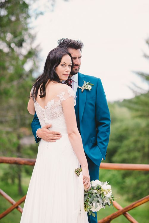 Bride in Naomi Neoh Gown & Groom in French Connection Suit