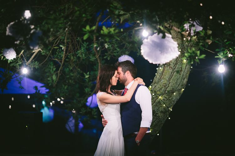 Bride Naomi Neoh Gown & Groom in French Connection Suit under Festoon Lights
