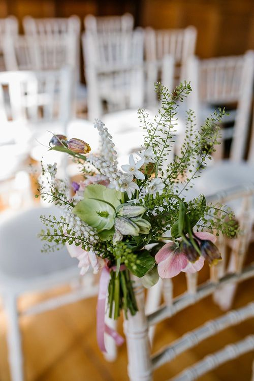 Aisle Chair Back Flowers | Spring Wedding at Hengrave Hall | Katherine Ashdown Photography