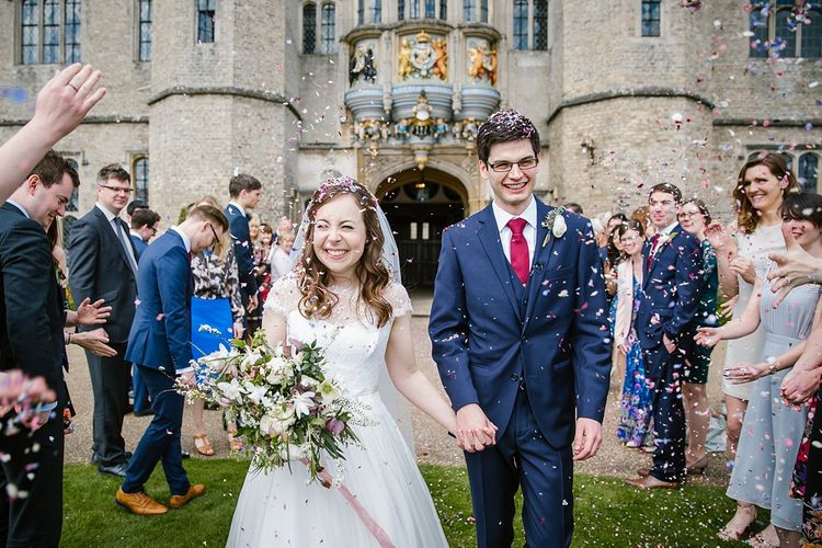 Confetti Moment | Bride in Naomi Neoh Fleur Gown | Groom in Moss Bros Suit | Spring Wedding at Hengrave Hall | Katherine Ashdown Photography