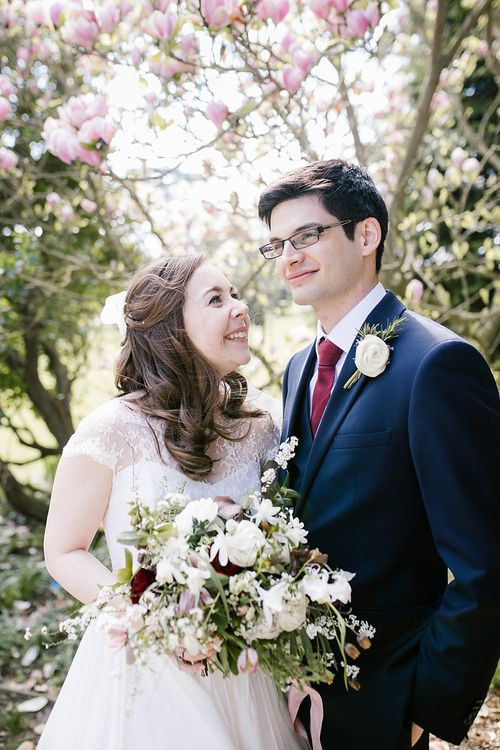 Bride in Naomi Neoh Fleur Gown | Groom in Moss Bros Suit | Spring Wedding at Hengrave Hall | Katherine Ashdown Photography