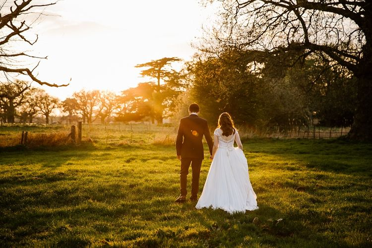 Golden Hour | Bride in Naomi Neoh Fleur Gown | Groom in Moss Bros Suit | Spring Wedding at Hengrave Hall | Katherine Ashdown Photography
