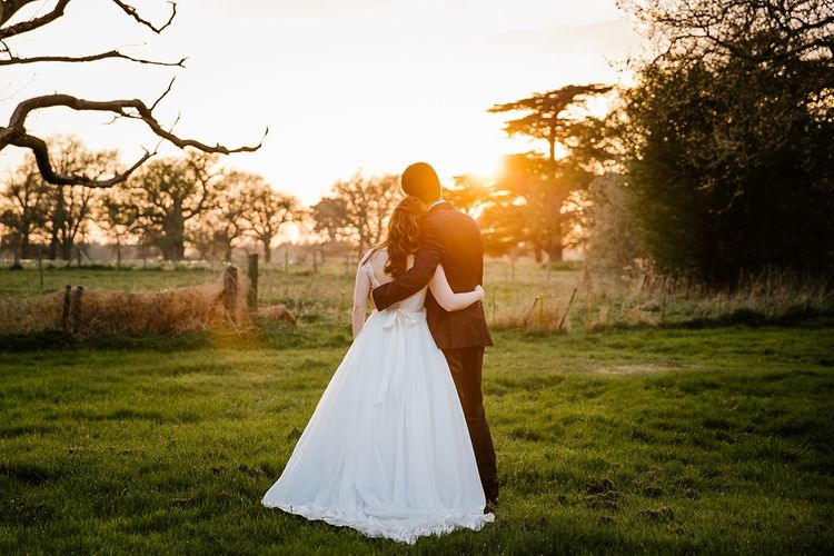 Sunset | Bride in Naomi Neoh Fleur Gown | Groom in Moss Bros Suit | Spring Wedding at Hengrave Hall | Katherine Ashdown Photography