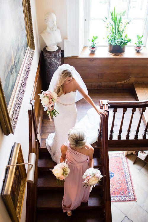 Elegant Bride in Pronovias Wedding Dress & Bridesmaids in Pink Multiway Dresses