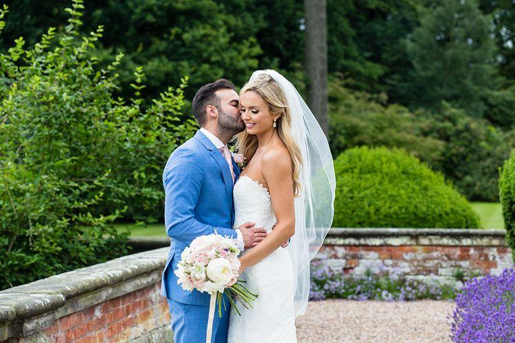 Bride in Pronovias Wedding Dress & Groom in Blue Hugo Boss Suit