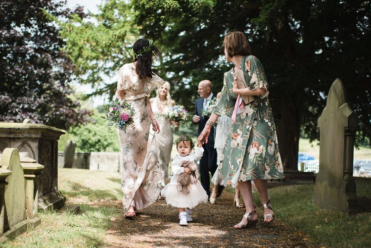 Flower Girl In Tutu // Woodstock Festival Inspired Wedding With Bespoke Dress And Floral Bridesmaids Dresses At Sandon Hall Images By Emma Hare Photography