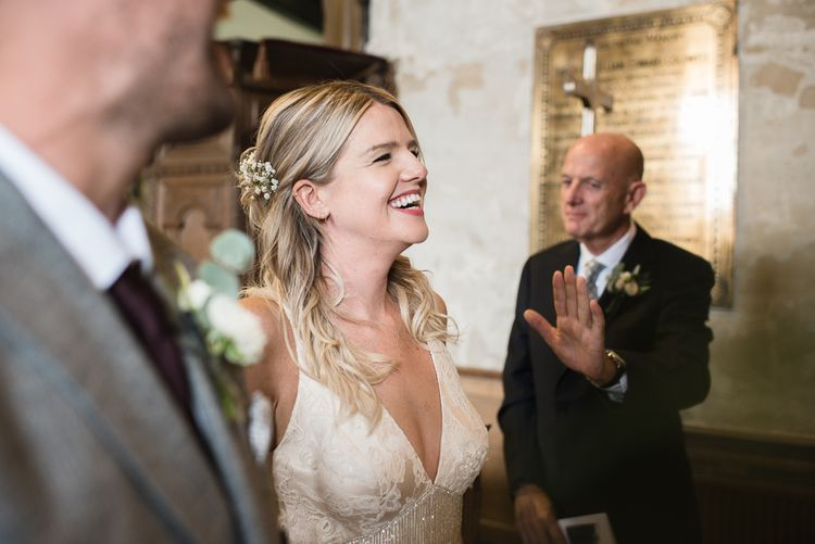 Bride In Bespoke Wedding Dress With Fringing // Woodstock Festival Inspired Wedding With Bespoke Dress And Floral Bridesmaids Dresses At Sandon Hall Images By Emma Hare Photography