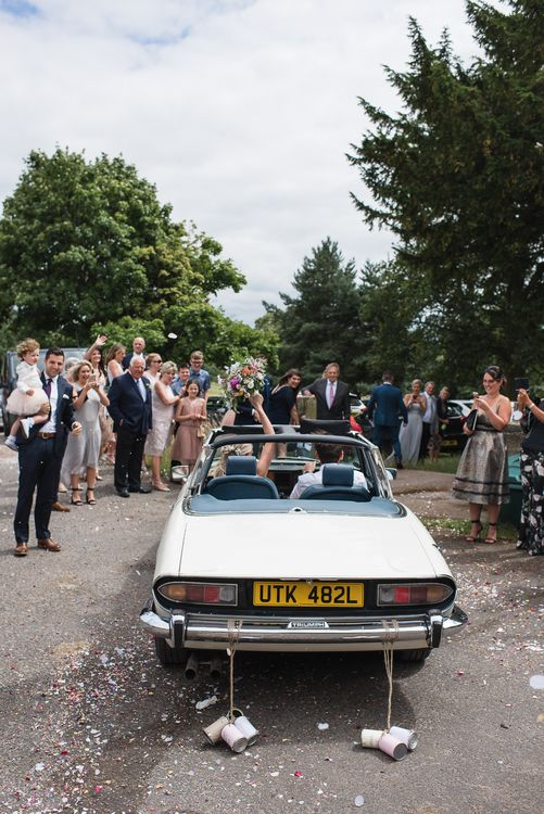 Vintage Wedding Car // Woodstock Festival Inspired Wedding With Bespoke Dress And Floral Bridesmaids Dresses At Sandon Hall Images By Emma Hare Photography