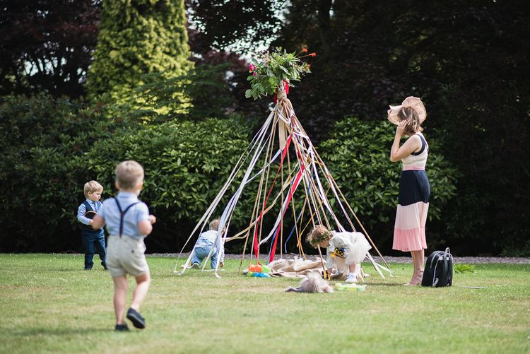 Tipi For Kids Entertainment At Wedding // Woodstock Festival Inspired Wedding With Bespoke Dress And Floral Bridesmaids Dresses At Sandon Hall Images By Emma Hare Photography