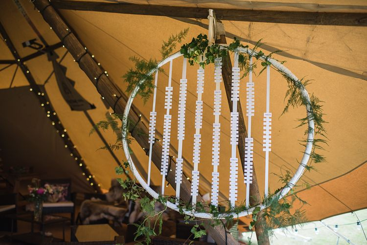 Floral Hoop Table Plan For Wedding // Woodstock Festival Inspired Wedding With Bespoke Dress And Floral Bridesmaids Dresses At Sandon Hall Images By Emma Hare Photography