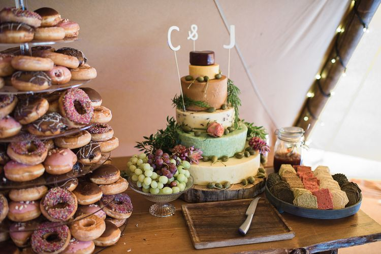 Krispy Kreme Wedding Tower // Woodstock Festival Inspired Wedding With Bespoke Dress And Floral Bridesmaids Dresses At Sandon Hall Images By Emma Hare Photography