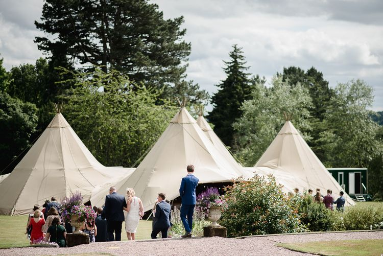 Big Chief Tipis // Woodstock Festival Inspired Wedding With Bespoke Dress And Floral Bridesmaids Dresses At Sandon Hall Images By Emma Hare Photography
