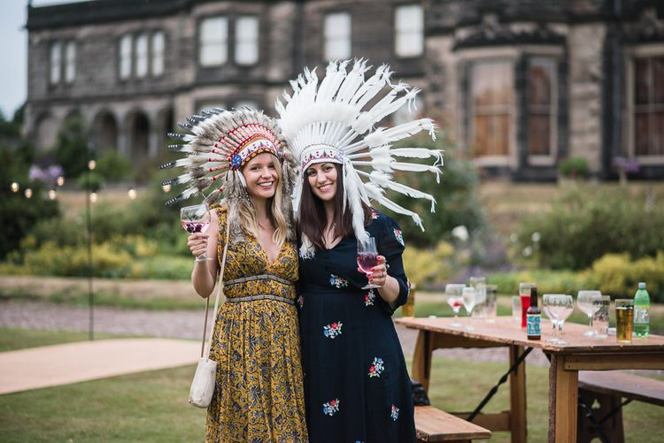 Festival Headdresses For Wedding // Woodstock Festival Inspired Wedding With Bespoke Dress And Floral Bridesmaids Dresses At Sandon Hall Images By Emma Hare Photography