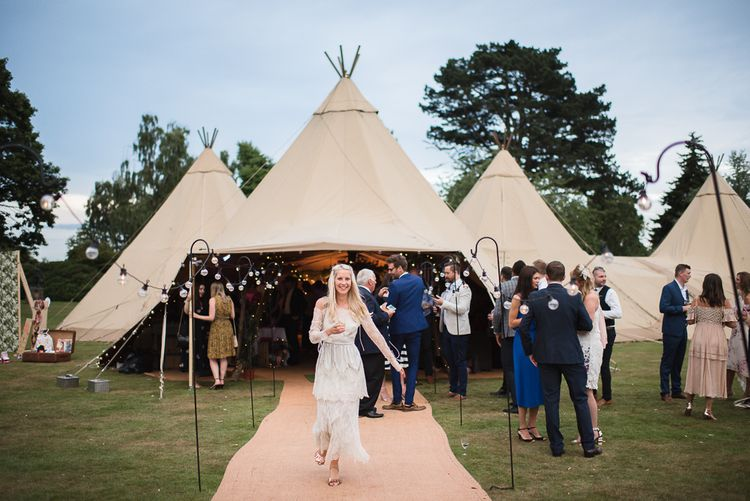 Big Chief Tipi For Wedding // Woodstock Festival Inspired Wedding With Bespoke Dress And Floral Bridesmaids Dresses At Sandon Hall Images By Emma Hare Photography