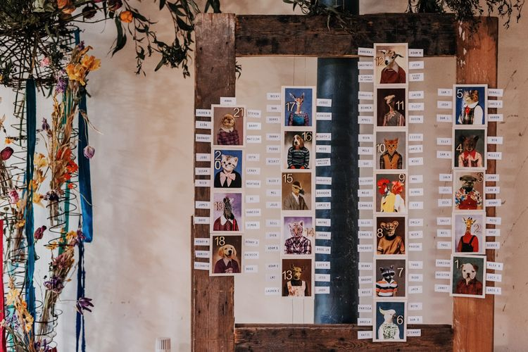 Animal Postcard Table Plan For Wedding // Vintage Inspired Canal Boat Wedding With Dried Flowers And Edison Bulb Decor Images From El Hitched Videography By Jo And Jody Films