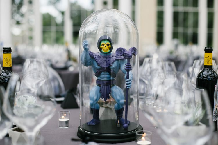Iconic 80s Figure (Skeleton - He-Man) in Bell Jar Table Centrepiece Wedding Decor | Monochrome Wedding at Syon Park London | Chris Barber Photography | Second Shooter Beatrici Photography