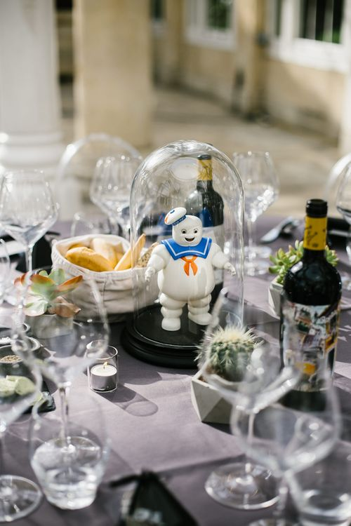 Iconic 80s Figure (Marshmallow Man - Ghostbusters) in Bell Jar Table Centrepiece Wedding Decor | Monochrome Wedding at Syon Park London | Chris Barber Photography | Second Shooter Beatrici Photography