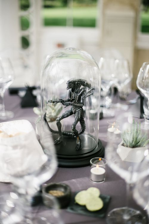 Iconic 80s Figure (Alien) in Bell Jar Table Centrepiece Wedding Decor | Monochrome Wedding at Syon Park London | Chris Barber Photography | Second Shooter Beatrici Photography