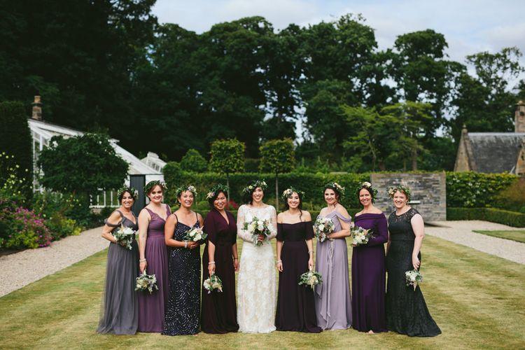 Group shot   Bridemaids in purples   Carlowrie Castle, Edinburgh, Scotland   Bride wears Dana Bolton   Images by Fraser Stewart