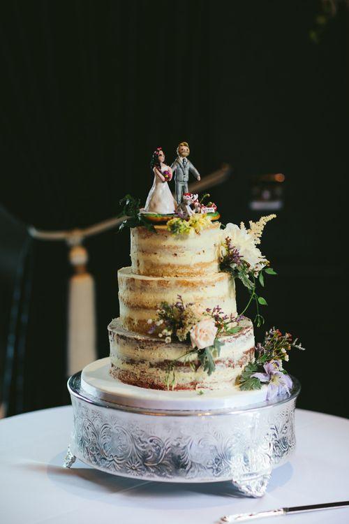 Cake by Bibi's Bakery   Carlowrie Castle, Edinburgh, Scotland   Bride wears Dana Bolton   Images by Fraser Stewart