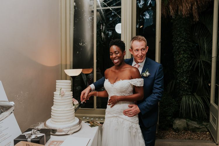 Hampton Court House Wedding With Pastel Flowers & White Hanging Lanterns With Children's Entertainment & Images From Joanna Nicole Photography