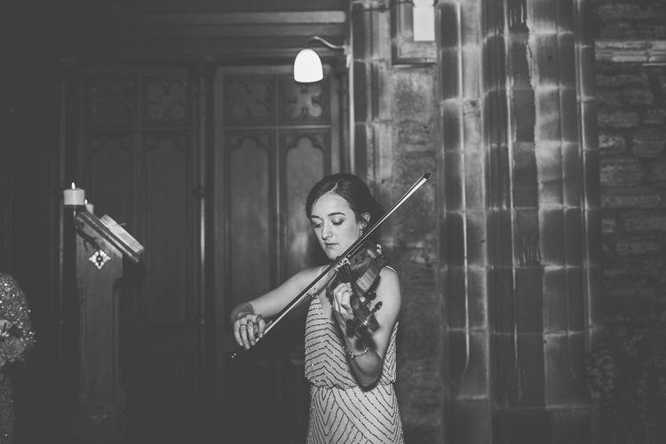 Bridesmaid Playing Strings