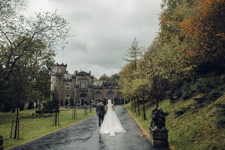 Bride in Bespoke Ian Stuart Gown with Detachable Tulle Skirt Outside Drumtochty Castle in Scotland
