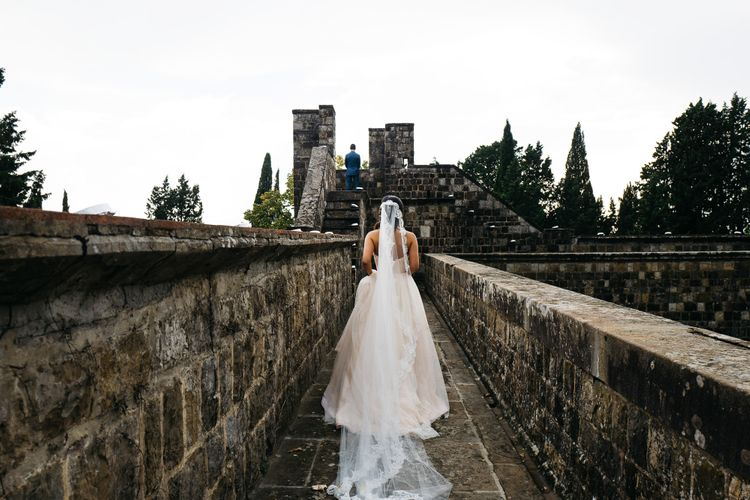 First Look   Modern Trousseau Eveline Wedding Dress   Groom in Suit Supply   Stefano Santucci Studio Photography   Second Shooter Giuseppe Marano   Gattotigre Films