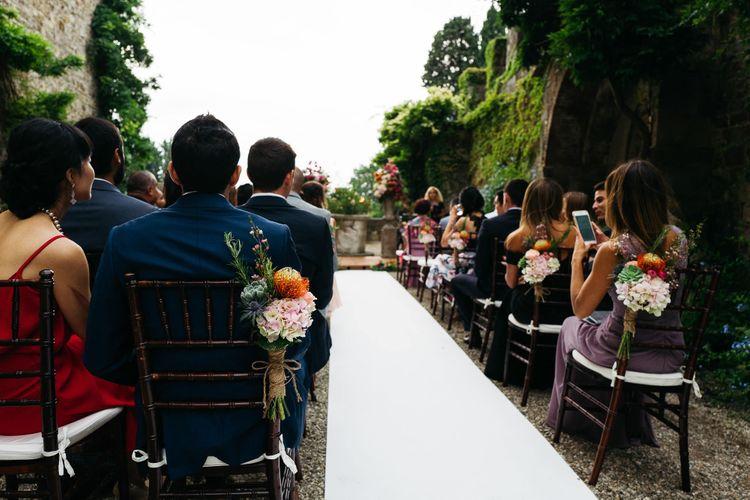 Aisle Chair Back Flowers   Stefano Santucci Studio Photography   Second Shooter Giuseppe Marano   Gattotigre Films