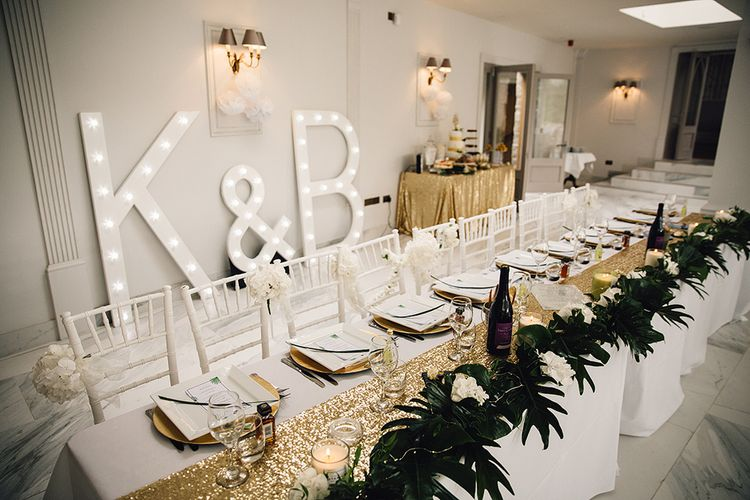 Elegant Top Table with Light Up Letters Backdrop