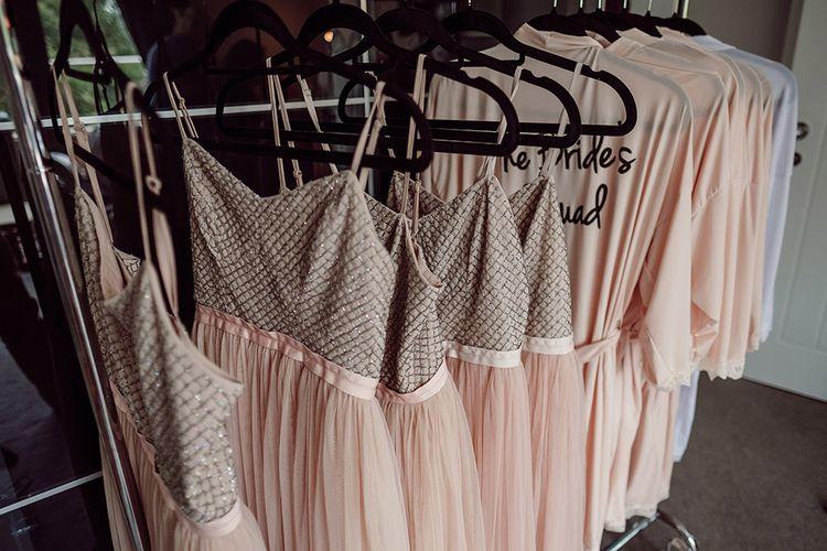Needle & Thread Bridesmaid Dresses   Rustic At Home Tipi Reception with Blush Colour Scheme   Jason Mark Harris Photography   Harris Films