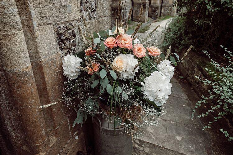 Milk Churn Wedding Flowers   Traditional Church Wedding Ceremony with Blush Colour Scheme   Jason Mark Harris Photography   Harris Films