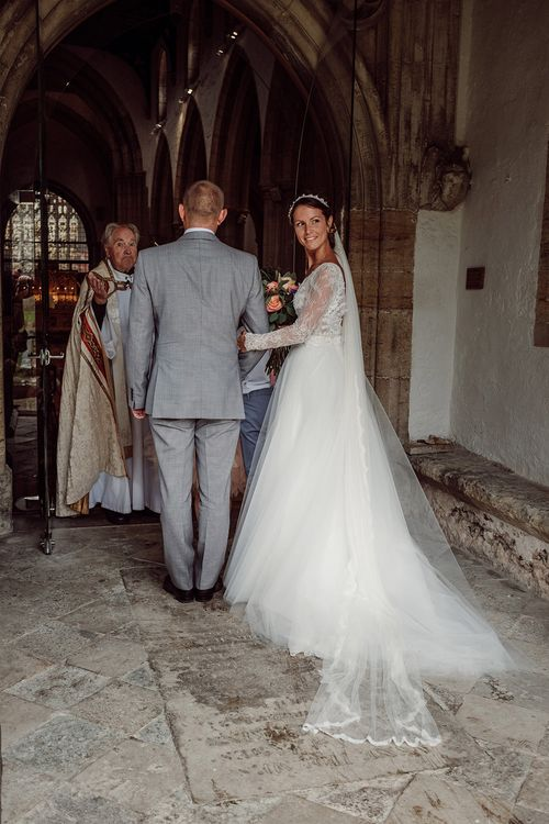 Bridal Entrance in Anna Georgina Wedding Gown & Augusta Jones Tulle Skirt   Traditional Church Wedding Ceremony with Blush Colour Scheme   Jason Mark Harris Photography   Harris Films