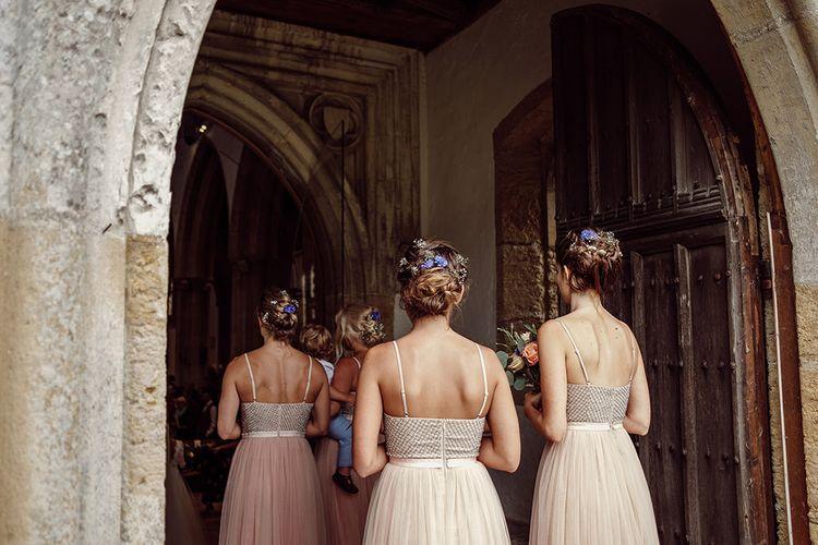 Bridesmaid Entrance in Needle & Thread Dresses   Traditional Church Wedding Ceremony with Blush Colour Scheme   Jason Mark Harris Photography   Harris Films