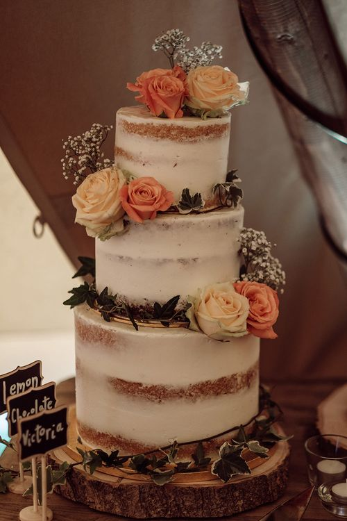 Semi Naked Wedding Cake with Flowers   Rustic At Home Tipi Reception with Blush Colour Scheme   Jason Mark Harris Photography   Harris Films