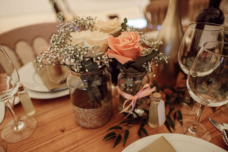 Table Scape with Flower Stems in Jars   Rustic At Home Tipi Reception with Blush Colour Scheme   Jason Mark Harris Photography   Harris Films