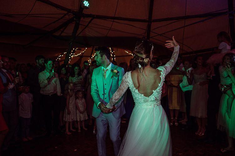 First Dance   Bride in Anna Georgina Wedding Gown & Augusta Jones Tulle Skirt   Groom in Grey Burton Suit   Rustic At Home Tipi Reception with Blush Colour Scheme   Jason Mark Harris Photography   Harris Films