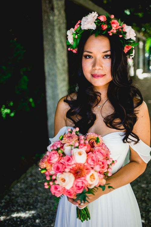 Bride in Tatyana Mereny Wedding Dress with Coral Flower Crown and Bouquet