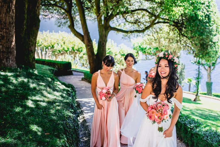 Bride in Tatyana Mereny Wedding Dress and Bridesmaids in Peach Twobirds Dresses