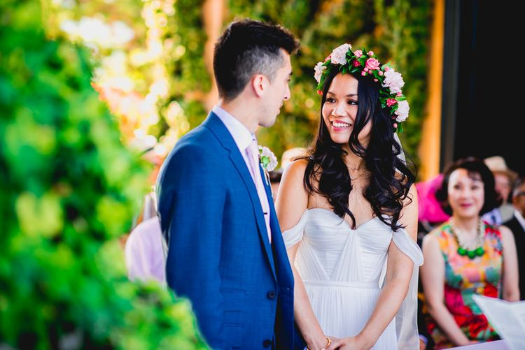 Bride in Tatyana Mereny Wedding Dress and Groom in Thom Sweeney Suit