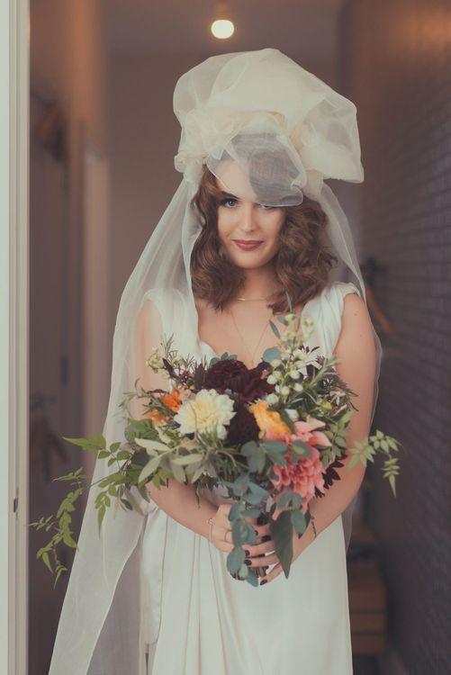 Stylish Bride in Alice Temperley Wedding Dress & Chloe Haywood London Veil