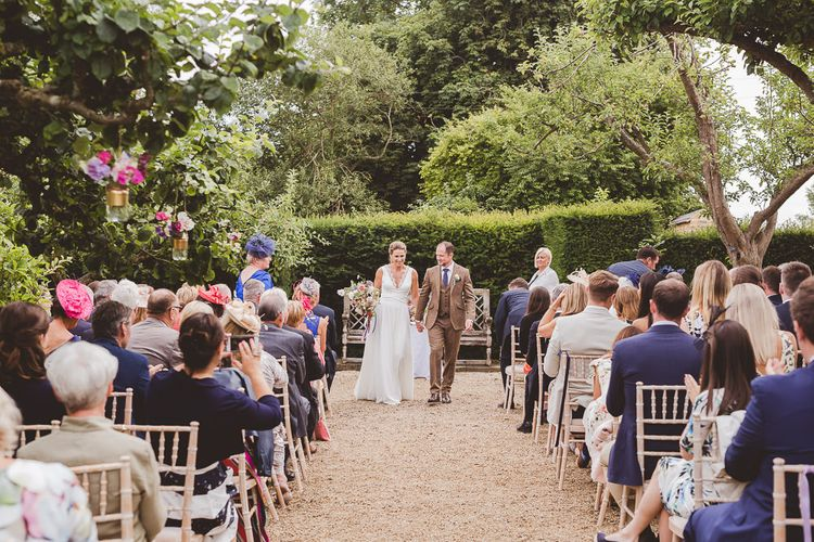 Outdoor Ceremony at Sulgrave Manor Northamptonshire | Bride in Charlie Brear Wedding Dress | Groom in Brown check Wool Suit | Nicola Casey Photography