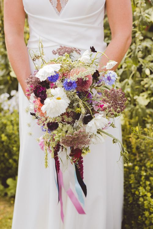 Wild Flower Bouquet with Ribbons | Bride in Charlie Brear Gown | Outdoor Ceremony at Sulgrave Manor Northamptonshire | Nicola Casey Photography
