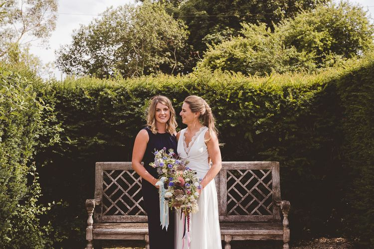 Bride in Charlie Brear Gown | Bridesmaid in Navy Phase Eight Dress | Outdoor Ceremony at Sulgrave Manor Northamptonshire | Nicola Casey Photography
