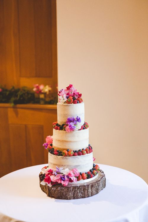 Semi Naked Wedding Cake with Fruit & Flower Decor | Outdoor Ceremony at Sulgrave Manor Northamptonshire | Nicola Casey Photography