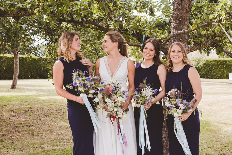 Bridal Party | Bride in Charlie Brear Gown | Bridesmaids in Navy Phase Eight Dresses | Outdoor Ceremony at Sulgrave Manor Northamptonshire | Nicola Casey Photography