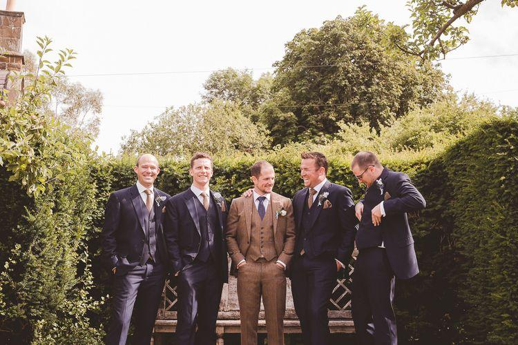 Groom in Brown Tweed Suit | Groomsmen in Navy Suits | Outdoor Ceremony at Sulgrave Manor Northamptonshire | Nicola Casey Photography