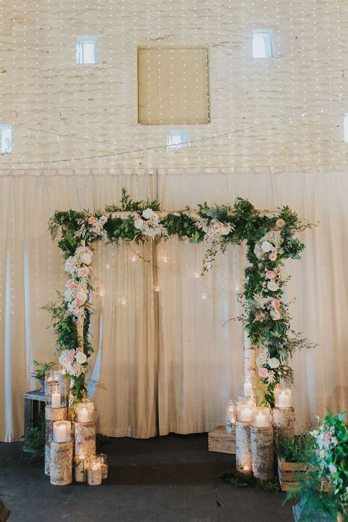 Wooden Arch with Floral Decor | Altar Decor | Pink & Gold Summer Wedding at East Riddlesden Hall Barn, Wiltshire | Laura Calderwoods Photography